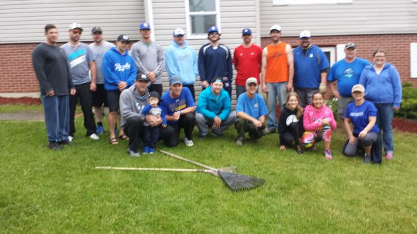Members of the 2015 Peterbilt DQ Royals taking a break from yard work. The team lent a hand at Chrysalis House for some spring cleaning.